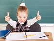 Schoolchild in classroom near blackboard.