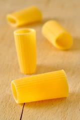 Rigatoni pasta on a wooden board