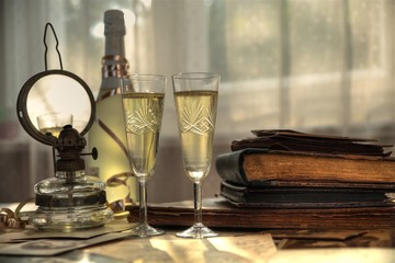 Champagne and old books and letters.