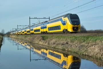 Dutch train en route along canal