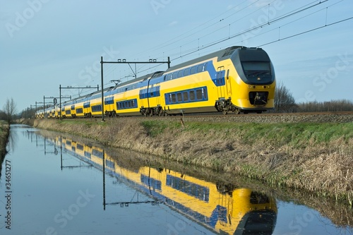 Dutch train en route along canal