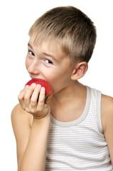 boy eating red apple
