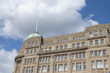 A Victorian Office Block with a Green Dome under a blue sky