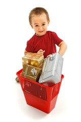 Little boy throwing presents in garbage bin
