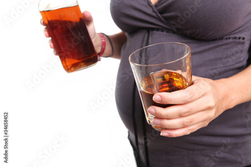 Pregnant Woman With a Glass of Whiskey