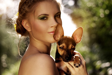 Portrait of a beautiful girl with Miniature Pinscher