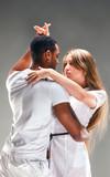 Fototapety Young couple dances Caribbean Salsa, studio shot