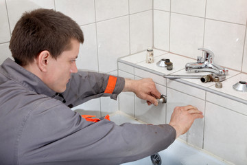 Plumber  fixing water pipe