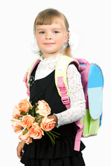 First grader girl in school uniform with a bouquet of flowers an