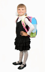 student girl in school uniform with a backpack on a white backgr