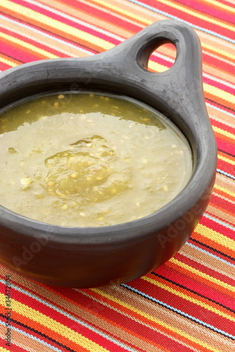 tomatillo sauce in colombian clay dish