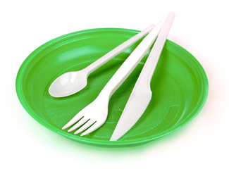 plastic cutlery on green plate isolated on white