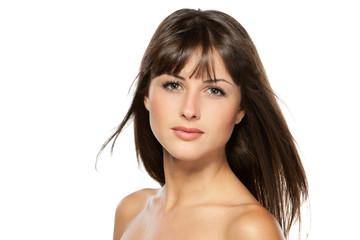 Closeup portrait of beautiful female,over white background