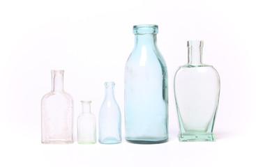 Vintage glass bottles on white