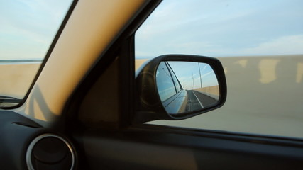Sunset side mirror. Confederation Bridge, PEI, Canada