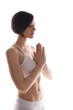 Young woman in white training yoga - relaxed pose