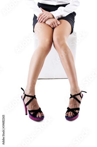 Shapely legs, a girl in sandals high-heeled. Isolated on white.