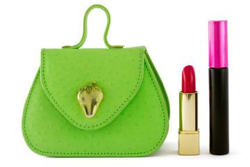 Green bag, red lipstick, black mascara