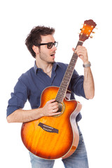 Funny Young Man Playing Guitar