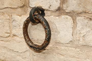 Rusty old ring at a brickwork wall