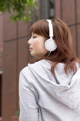 Asian woman in headphone