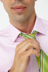 Buisnessman putting on tie