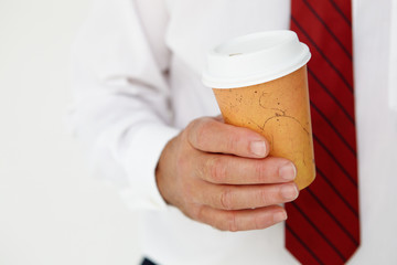 Businessman holding takeout coffee