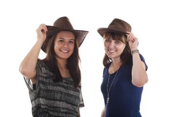 Frauen grüssen mit Hut