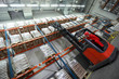 Worker   on   forklift loader loading sacks in warehouse