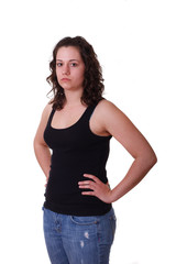 Young Brunette in Black Tank Top and Blue Jeans Hands on Hips to