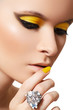 Beautiful model with bright fashion make-up, crystal ring