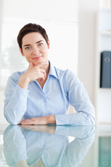 Portrait of a Businesswoman sitting behind a desk
