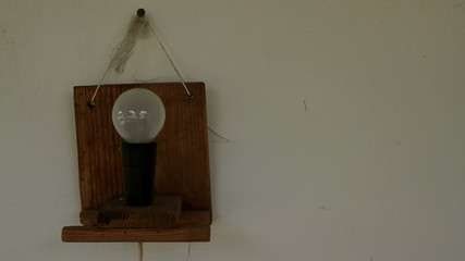 loop-able short pulsing home-made lamp hanging on wall