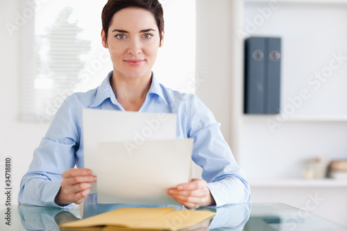 Portrait of a brunette Businesswoman sitting behind a desk with