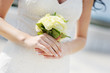 Bride holding beautiful white wedding bouquet
