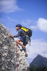 Young boy rock climbing.
