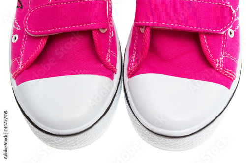 Pink sneakers isolated on white background