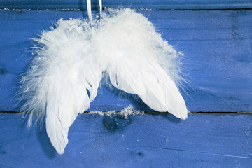 White angel wings on blue background