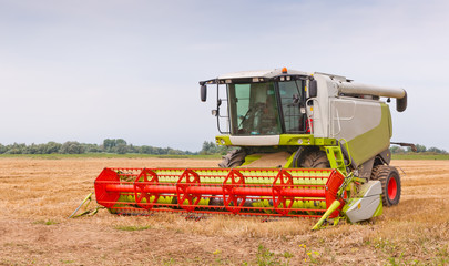 A closeup of a combine in the field after work