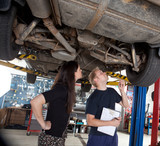 Mechanic Showing Customer Repairs