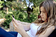 teenage girl with mobile cell phone outdoor