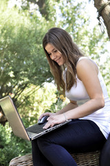 teenage girl with wireless laptop outdoor