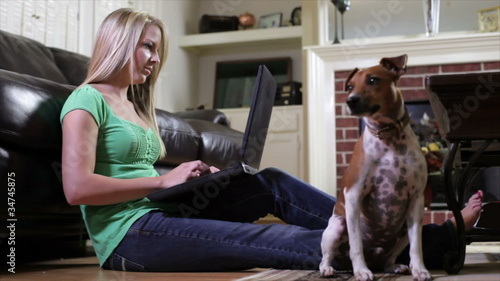 Girl on Laptop with Jack-Rat Terrier sitting obediently
