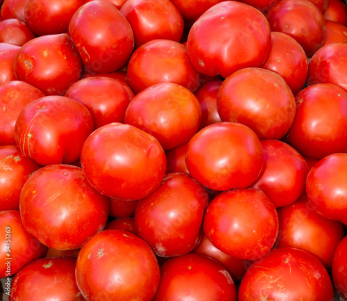 Red ripe tomatoes on display
