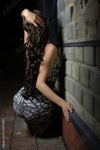 Back of a female with long curly hair