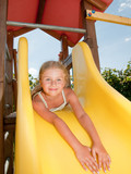 Happy childhood - little girl on the playground poster