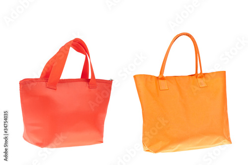 Colorful orange and red cotton bag on white isolated background.