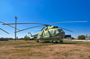 old Russian helicopter on the grass.