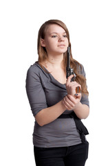 Girl with a gun in the hands
