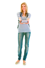 Full length portrait of teen girl with schoolbag giving books